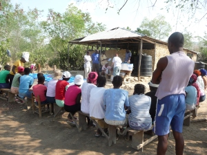 Village women prepare to get education on using the filters
